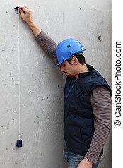Plasterer preparing wall