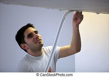 Plasterer repairing roof