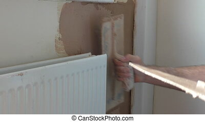 Plasterer working close up