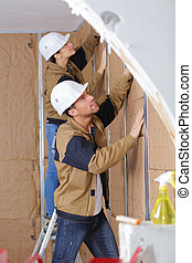 plasterers covering the wall