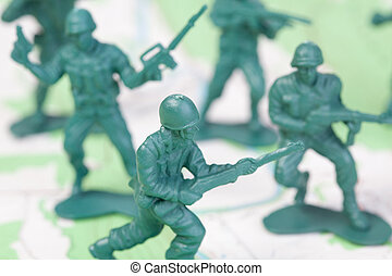Plastic Army Men Fighting on Topographic Map Squad Attacks