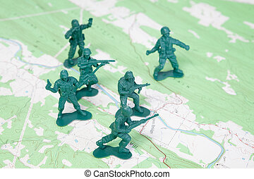 Plastic Army Men Fighting on Topographic Map.