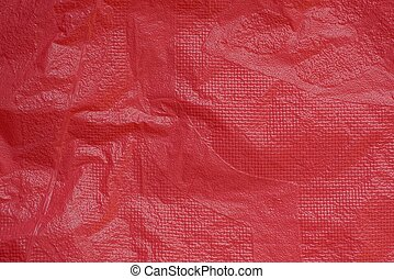 background of a piece of crumpled red bright cellophane