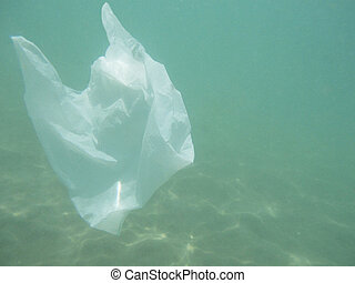 Plastic bag floating into the sea. Polluted enviromental....