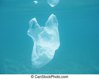 Plastic bag floating into the sea. Polluted environmental....