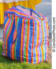 Plastic bag - Multi color plastic bag with zip in sunlight