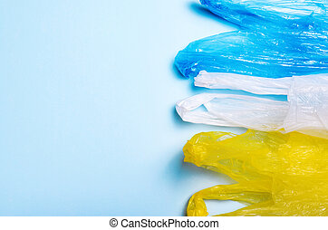 Plastic Bags on Blue Background, Recycle and Plastic Pollution Concept