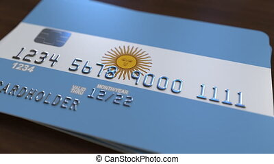 Plastic bank card featuring flag of Argentina. National...