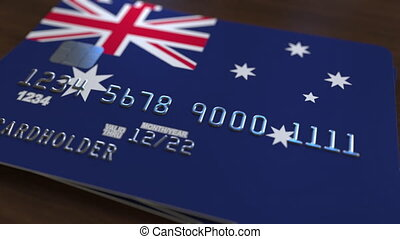Plastic bank card featuring flag of Australia. National banking system related animation