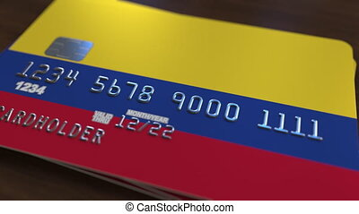 Plastic bank card featuring flag of Colombia. National...