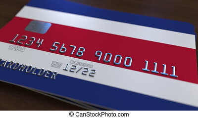 Plastic bank card featuring flag of Costa Rica. National...