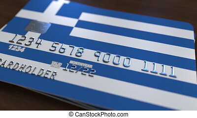 Plastic bank card featuring flag of Greece. National banking...
