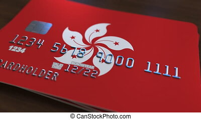 Plastic bank card featuring flag of Hong Kong. Banking...