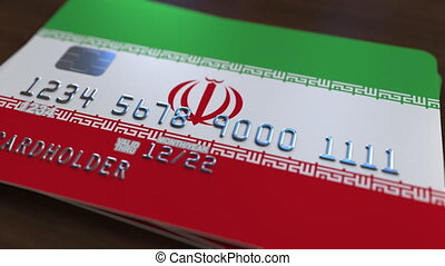 Plastic bank card featuring flag of Iran. National banking...