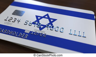 Plastic bank card featuring flag of Israel. National banking...