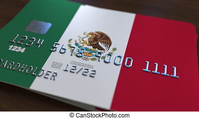 Plastic bank card featuring flag of Mexico. National banking system related animation