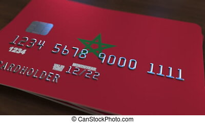 Plastic bank card featuring flag of Morocco. National banking system related animation