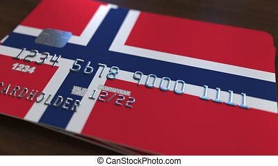 Plastic bank card featuring flag of Norway. National banking...