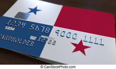 Plastic bank card featuring flag of Panama. National banking system related animation