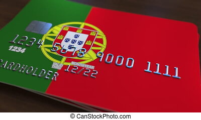 Plastic bank card featuring flag of Portugal. National...