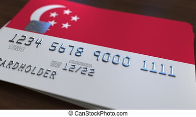 Plastic bank card featuring flag of Singapore. Singaporean...