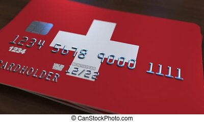 Plastic bank card featuring flag of Switzerland. National...