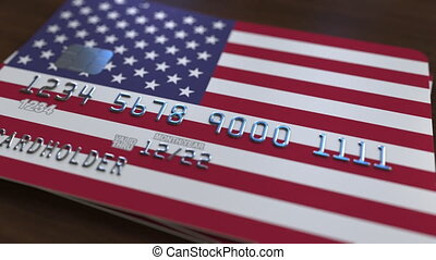 Plastic bank card featuring flag of the United States....