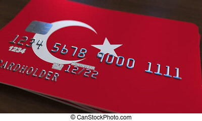 Plastic bank card featuring flag of Turkey. National banking...