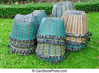 plastic basket on a green grass in park