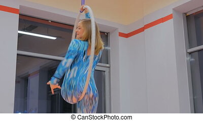 Plastic beautiful girl gymnast on acrobatic circus ring