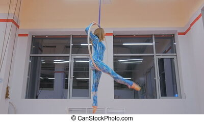 beautiful girl gymnast on acrobatic circus ring