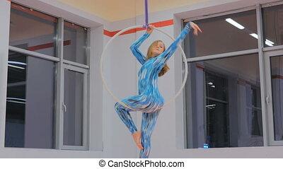 Plastic beautiful girl gymnast on acrobatic circus ring in...