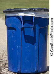 Plastic Blue Trash Can in a Park