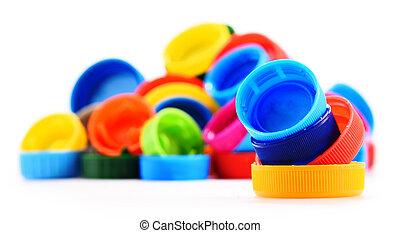 Plastic bottle caps isolated on white background