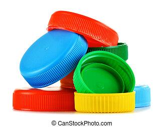 Plastic bottle caps isolated on white