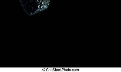 Plastic bottle falling in water on