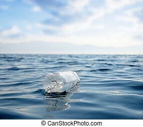 Plastic bottle floating in the ocean.