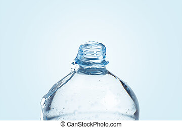 Plastic bottle full with water on blue background