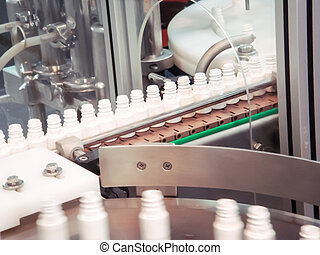 Plastic bottle on the conveyor in the production line