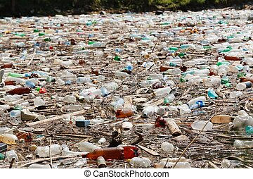 plastic bottle pollution - plastic bottles floating on water...