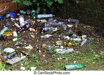 plastic bottles and other rubbish on the heavily polluted...