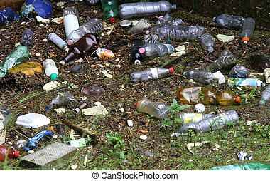 plastic bottles and other rubbish on the polluted river -...