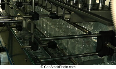 plastic bottles filled with water on the conveyor
