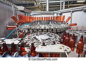 Plastic bottles for beer or carbonated beverage moving on conveyor