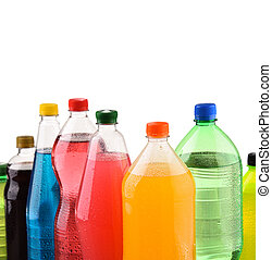 Plastic bottles of assorted carbonated soft drinks over...