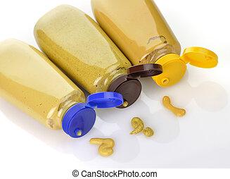 mustard - plastic bottles of honey ,dijon and spicy brown...