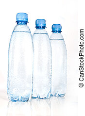 Plastic bottles of mineral water isolated on white...