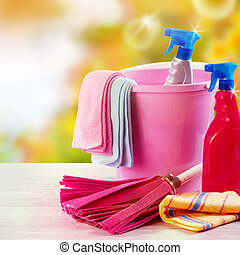 Plastic bucket with household cleaning supplies