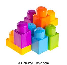 Plastic building blocks on background