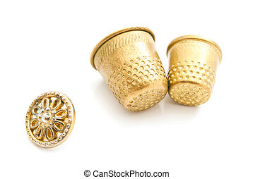 plastic button and thimbles on white background closeup